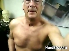 Older man strips and touches his body