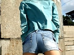 Enjoy photo session with bare titted girl in jeans short