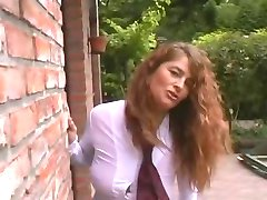 Sexy and busty curly MILF outdoor with 3 guys