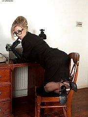 Michelle in prim suit, vintage nylons and sheer panties!