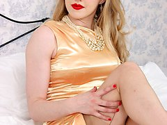 In shimmering gold satin, racy blonde Lucy enters the bedroom in lovely vintage FF hosiery and undies.