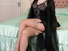 Seductress Shay in frilly, sheer gown, vintage corselette and RHT nylons.