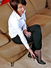 Hot business lady aching to taste her yummy feet in black control top hose