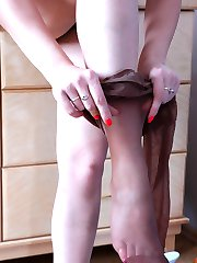 Just from the shower cutie puts on her suntan pantyhose and her short skirt