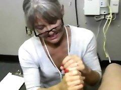 Mature handjob MILF with glasses jerking