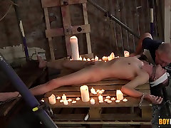 Naked twink is chained down by his wrists ankles and neck