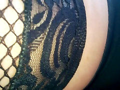 Upskirt black fishnet stockings and black panties