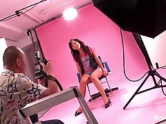 Asian teen gets finger fucked during a photo shoot