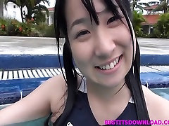 Busty asian teen posing in swimming suit