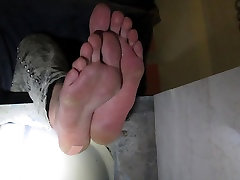 Girl - football player - her bare feet from down
