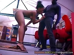 Horny dark booty kneels for black cock