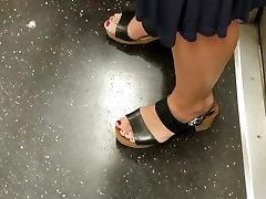 Candid feet of mature milf