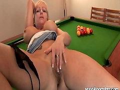 Mature pornstar masturbates on a pool table