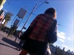 Upskirt on the street. Pink panties and black stockings