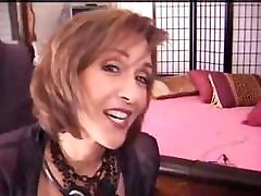 Mature babe is horny and strips down to rub and dildo her pussy