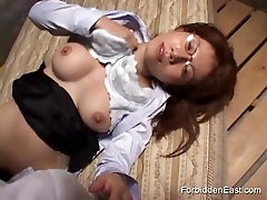 Oriental woman in glasses and shirt loves to lick and suck a hard cock