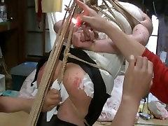 Jyosouko Fujikos BDSM rope and candle