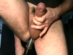 Milking his meaty uncut cock