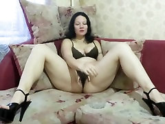 Girl smokes and masturbates pussy in panties