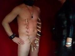 Dominatrix gives zipper to slave Dominatrixi spanking.