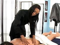 Ebony masseuse sucks cock