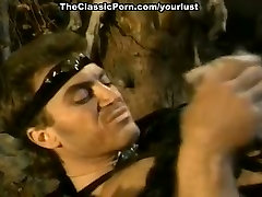 Vintage blonde and retro porn actor in 1980s porn video featuring savage barbarian sex