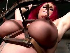 Redhead slut is tormented in BDSM sex video