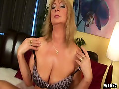 Busty blonde mature Rosalyn fondles her soaking twat with fingers