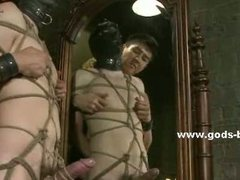 Classy dressed gay captured in a cage is abused in extrem bdsm sex getting spanked