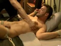 Big hot guy letting other guys painfully tasing his cock