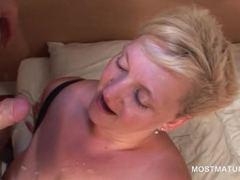 Slutty mature masturbates and eats cock