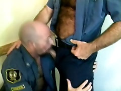 Men in uniform sneak off to a corner to suck each others cocks