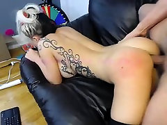 Busty blonde cougar in black stockings spreads her legs for