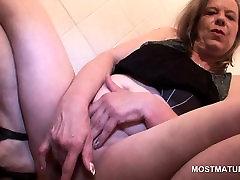 Blonde mature finger fucking her juicy twat