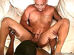 Two black dudes sharing the ass of a white guy