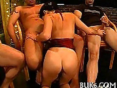 Group pissing on lusty girl