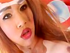 Hot Asian TS Proud strips off her red lingerie and jerks off