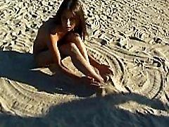 This teen nudist strips bare at a public beach