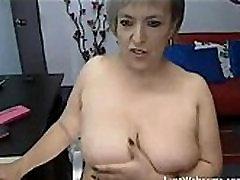 Mature woman masturbates on cam
