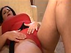 Busty mature brunette in mini skirt panty play