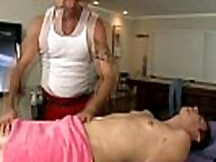 Straight guy deepthroated by muscular gay masseur