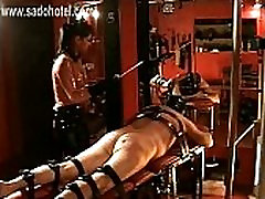 Horny dominatrix with beautiful big tits hits dirty slave very hard with a stick