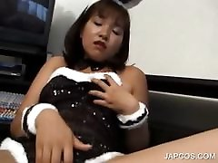 Asian slut in bunny outfit rubbing horny pussy