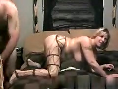 Blonde milf smokes a cigarette, while she gets fucked doggystyle.