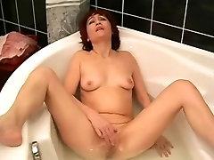 Mature Masturbates In Bathroom