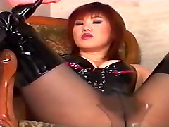 Japanese Domme in Latex Punishes Her Male Slave