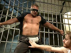 Officer Justice taken down and his giant cock edged by two perverts