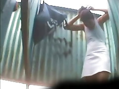 Amateur girl changing her panty up skirt in beach cabin