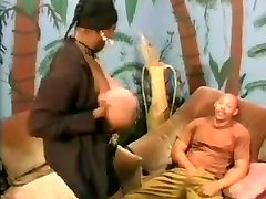 Busty Ebony MILF having fun with a younger black guy