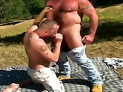 Hairy bear and cub mating in wild nature